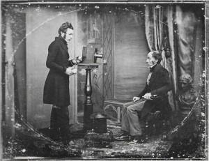 Jabez_Hogg_Making_a_Portrait_in_Richard_Beard's_Studio,_1843